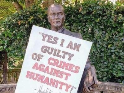 """Yes, I am guilty of crimes against humanity"": poster appears on the statue of Ataturk"